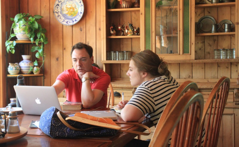 Stowe Story Labs Mentor Chris Millis reviews notes with participant Julia Batista at Stowe Story Labs' Writers' Retreat