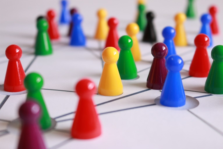 Multicolored Game Pieces on Board